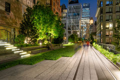 High Line promenade at Twilight, Chelsea, Manhattan, New York City. The High Line promenade illuminated at twilight surrounded by modern and older buildings in Royalty Free Stock Photo