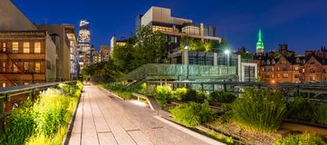 The High Line at twilight, panoramic view. Chelsea. Manhattan, New York City. Panoramic view of the High Line promenade at twilight with city lights and Stock Images
