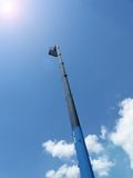 High long industrial crane arm on blue sky,heaven, Royalty Free Stock Photo