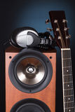 High loudspeaker tower with acoustic guitar Stock Images
