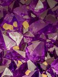 High magnification macro photo of amethyst crystals. Yellow ones are calcite crystals royalty free stock images