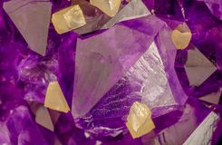 High magnification macro photo of amethyst crystals with yellow calcite cubes.  royalty free stock photography