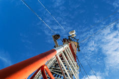 High mast metal structure telecommunication on tower with blue s Stock Photography