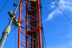 High mast metal structure telecommunication on tower with blue s Stock Photos