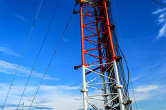 High mast metal structure telecommunication on tower with blue s Royalty Free Stock Image