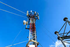 High mast metal structure telecommunication on tower with blue s Royalty Free Stock Images