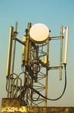 High mast metal structure telecommunication on tower with blue sky. Stock Photos