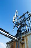 High mast metal structure telecommunication on tower with blue sky. Stock Photo
