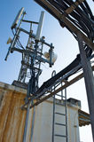 High mast metal structure telecommunication on tower with blue sky. Stock Image