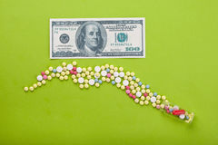 High medical cost. Pills and tablets with US paper currency Stock Images