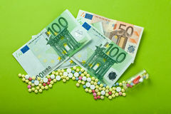 High medical cost. Pills and tablets with Euro paper currency Royalty Free Stock Image
