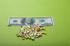 High medical cost. Pills and tablets with US dollar Royalty Free Stock Image