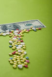 High medical cost. Pills and tablets with US paper currency Royalty Free Stock Photography