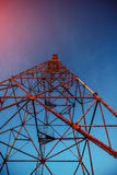 High metal tower on blue sky. Stock Images