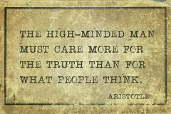 High-minded Aristotle. The high-minded man must care more for the truth than for what people think - ancient Greek philosopher Aristotle quote printed on grunge royalty free stock photos