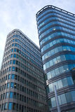 High modern office buildings in a city over blue s Royalty Free Stock Image