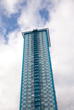 High modern residential building over blue sky with clouds Stock Photos