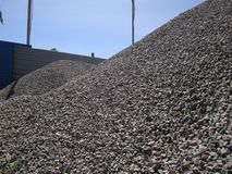 High mound of construction rubble gray. High mound of construction rubble of gray color for filling the cushion under the basement royalty free stock photography