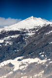 High mountain in Austrian Alps covered by snow at sunny day Royalty Free Stock Photo