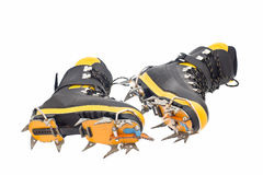 High mountain boots with crampons. Pair of the high mountain boots with crampons stock images