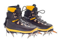 High mountain boots with crampons Stock Photography