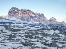High mountain cliffs in the Dolomites. Evenning with low clouds Royalty Free Stock Image