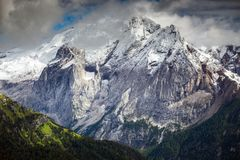 High mountain cliffs in the Dolomites. At dawn Stock Photo