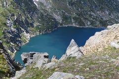 High-mountain dam lake Royalty Free Stock Images