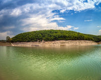 High mountain Lake with blue sky Cloudscape wide angle Royalty Free Stock Photo