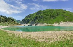 Free High-mountain Lake Kezenoi Am — The Largest Lake In The Area Of The Chechen Republic And The Greater Caucasus . Sunny Day Stock Photography - 152345222