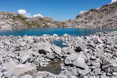 High mountain lake in the middle of the rocks Stock Image