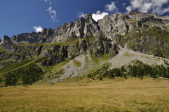 High Mountain landscape. Summertime green mountain landscape in the Alps with peaks, Alpe Buscagna, Devero, Italy Royalty Free Stock Image
