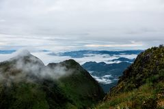 High mountain landscape background blue sky cloudy , fog around hill . nature national park at chiang dao Thailand . beautiful sce. High mountain landscape stock images