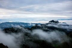 High mountain landscape background blue sky cloudy , fog around hill . nature national park at chiang dao Thailand . beautiful sce. Ne peak wildlife in winter stock photography