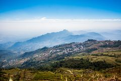 High mountain landscape view with blue sky cloudy , fog around hill . beautiful scene peak wildlife in winter . traveller way . na. Ture national park at phu tub royalty free stock photos