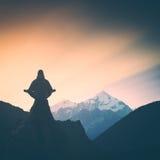 High mountain meditation. Instagram stylisation Stock Photos