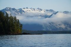 Alaska sound waters. High mountain mist above ocean waters Royalty Free Stock Photography