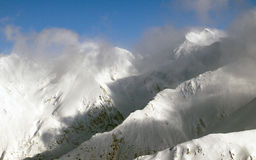 High mountain panorama. The second highest summit in Romania, Negoiu peak (2535m), seen among the clouds Royalty Free Stock Photos