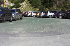 High mountain parking. Cars parked on a high mountain road in Slovenian Alps Stock Images