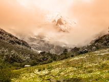 High mountain peak covered with fog Royalty Free Stock Photography