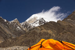High Mountain Peak and Cropped Orange Tent Royalty Free Stock Photo