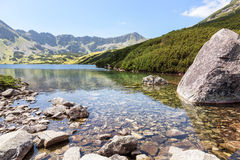 High mountain in Poland. National Park - Tatras. Ecological reserve. Mountain lake. Stock Photo