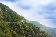 High mountain road in Himalayas. Picture taken during bicycling trip in autumn. Himalayas, India Royalty Free Stock Image