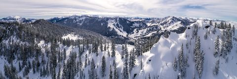 Aerial of Winter Resort from Snowy Peak in Cascade Mountain Rang royalty free stock photos