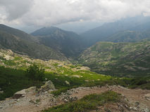 High mountain view scenery with the storm clouds and golden ligh Royalty Free Stock Photo