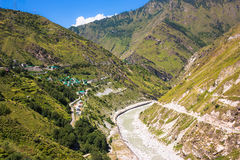 High mountain village and river in Himalayas. Picture taken during bicycling trip in autumn. Himalayas, India Royalty Free Stock Photography