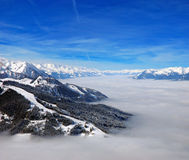 High mountains above the clouds Royalty Free Stock Photos