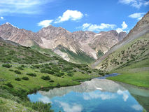 High mountains with amazing lake. In Kirghistan Royalty Free Stock Image