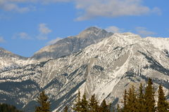 High mountains background. Jasper national park, alberta, canada, sunny weather, clouds over rocky mountains Royalty Free Stock Photography