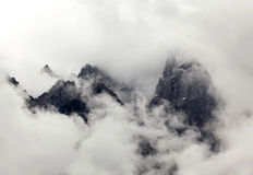 High mountains in the clouds Royalty Free Stock Photography